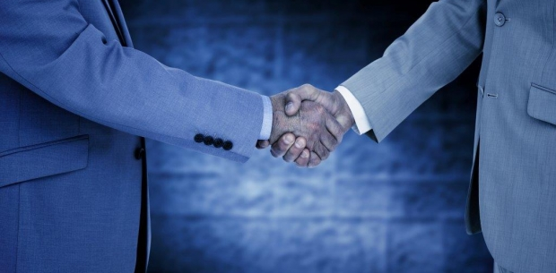 Employer shaking hands with a new employee