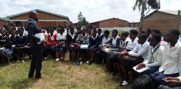 Engaged Secondary School Students in Africa Listening to a Talk by ABE Staff